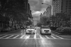 Rainy day street scene at Park Avenue New York City, Black and W Stock Image