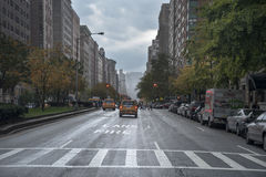 Rainy day street scene at Park Avenue New York City Stock Photos