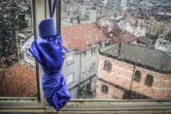 Rainy Day. An umbrella hanging on a window with rain outside Royalty Free Stock Photography