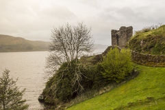 Rainy day at the Urquhart Castle. View of the Loch Ness shore with the Urquhart Castle on a rainy day Stock Photo