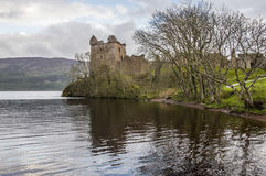 Rainy day at the Urquhart Castle. View of the Loch Ness shore with the Urquhart Castle on a rainy day Stock Photography