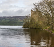 Rainy day at the Urquhart Castle. View of the Loch Ness shore with the Urquhart Castle on a rainy day Stock Photos