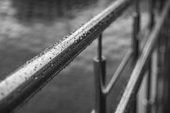 Rainy day. Rainy day, water drops on metal handrails royalty free stock photos