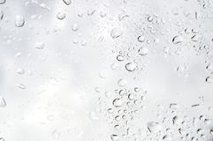 Rainy Day water drops on window - Droplets stock photo