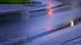 Rainy day, wet road and car light stock video footage