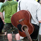 Rainy day wirh a brown guitar on a concert. Open air festival has a rainy day Royalty Free Stock Photo