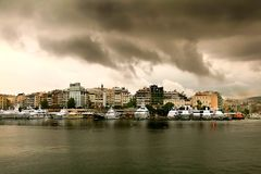 Free Rainy Day With Cloudscape.Luxury Yachts In A Row At Marina Zeas Stock Photos - 101688193