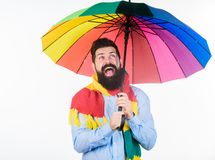 Rainy days can be tough to get through. Prepared for rainy day. Carefree and positive. Enjoy rainy day. Seasonal weather. Forecast. Man bearded hipster hold stock photo