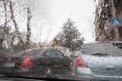 Rainy days, Evening, rain drops on the window with traffic blur. Blurry car silhouette. Autumn Abstract Backdrop Stock Images