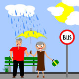 Rainy days. Happy mature couple waiting for the bus together under an umbrella on a rainy day Stock Photography