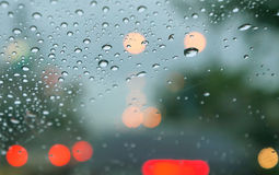 Rainy days,rain drops on the window with traffic blur Royalty Free Stock Photo