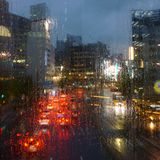 Rainy evening in the city. Raindrops on glass. Tokyo, Japan royalty free stock photo