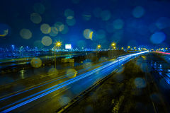 Rainy evening at the A4 highway. Car lights at a rainy evening at the A4 highway at Schiphol Airport in the Netherlands royalty free stock photos