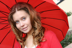 Rainy Fall. Girl with a red umbrella on the street Royalty Free Stock Photos