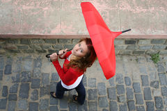 Rainy Fall. Girl with a red umbrella on the street Royalty Free Stock Photo