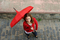 Rainy Fall. Girl with a red umbrella on the street Stock Images