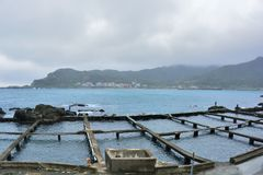 Rainy fishing harbor style. Royalty Free Stock Photo
