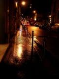 Rainy golden street in Paris. Golden street at night in Paris Royalty Free Stock Photo