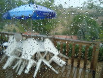 Rainy holiday. View through a window of a holiday cottage Royalty Free Stock Images