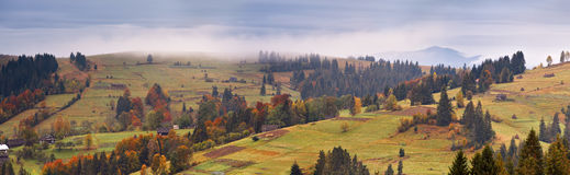 Rainy landscape of mountain village. Overcast autumn panorama. Stock Photo