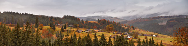 Rainy landscape of mountain village. Overcast autumn panorama. Stock Image