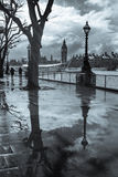 Rainy London. Big Ben and tree reflected in puddles on the Southbank Stock Images