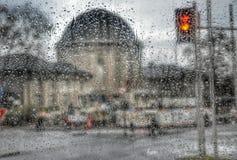 Rainy mood. Traffic lights in rain, rain drops window royalty free stock photos