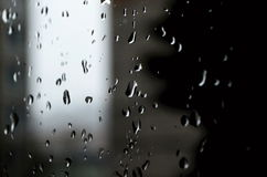 Rainy mood. Water drops running down the window while it rains outside royalty free stock photos