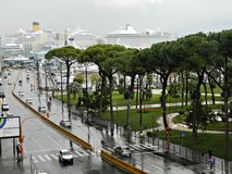 Rainy morning autumn  on the street in Naples. NAPLES, ITALY - NOVEMBER 2013 .  Rainy morning autumn  on the street in Naples. Harbor is at the background Royalty Free Stock Photography