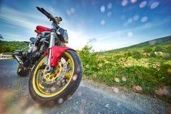 Rainy Mountain Landscape. Red motorbike on rainy mountain road landscape Royalty Free Stock Image