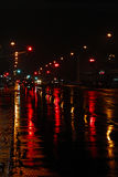 Rainy night in the city. Reflections of red lights and traffic in the city on a rainy evening Stock Photography
