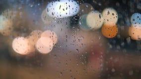 Rainy Night City Traffic Bokeh Background. 4K. Rainy Cars Night City Traffic Bokeh Background. 4K stock video footage