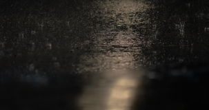 Rainy night and driving transport. Cars driving during the rain at night. Rain pouring and light from headlamps reflecting on dark wet road stock video footage