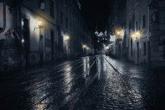 Rainy night in old city Stock Photos