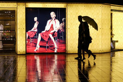 In the rainy night a pair of lover walks nearby th Royalty Free Stock Photo