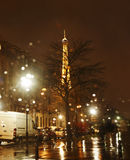 Rainy Night in Paris. Paris,France- December 31, 2012: Image of a Parisian street in a rainy New Years Eve night few minutes before the end of the 2012 year. Due Stock Photography