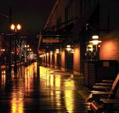 Rainy night in Portland, Oregon, USA. Reflective streets and walkway on Christmas Eve in the Pearl District, Portland, Oregon royalty free stock image
