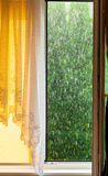 Rainy outside window. Downpour rain. Stock Photo