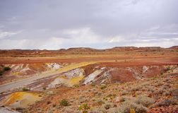 Rainy Painted Desert. Typical geography in the Painted Desert, with the rare sight of storm clouds and rain brewing over one of the driest places on earth South Royalty Free Stock Photography