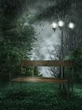 Rainy park. Rainy landscape with a park bench and lamp Stock Images
