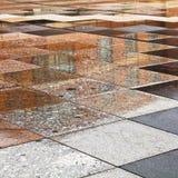 Rainy puddles on urban square Stock Photo