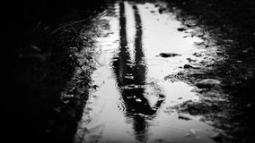 Rainy reflection. Female black and white reflection in the rain Royalty Free Stock Photo