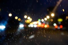 Rainy road through windscreen Royalty Free Stock Image