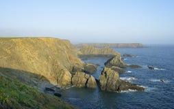 Rainy Rock & Gateholm Island. Evening Sun on Rainy Rock & Gateholm Island, Viewed from Pitting Gales Point, Pembrokeshire, Wales stock images