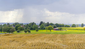 Rainy scenery with small village Royalty Free Stock Images