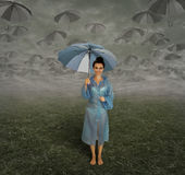 Rainy season and a girl. Stock Photos