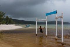 Woman sitting on the swing. Saracen Bay, Cambodia. Stock Photography