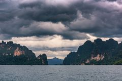 Rainy season with storm clouds in the sea stock image