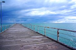 Rainy Sky & Long Jetty Stock Images
