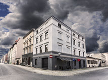 Rainy sky over street corner in Chelmno, Poland. Royalty Free Stock Images